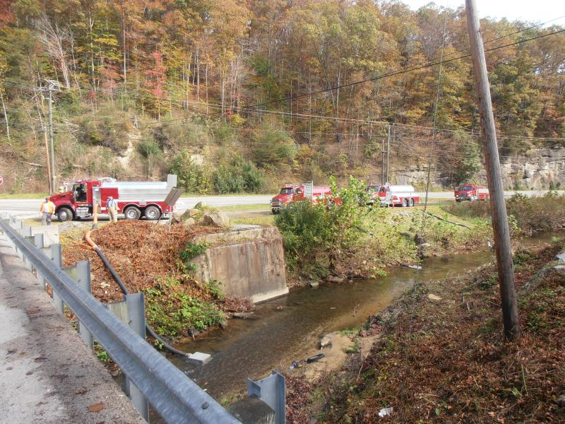 The fill site had 4 suction lines for vac tankers.  3 were on the east side of the bridge and a 4th on the west side.