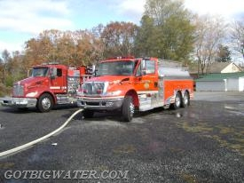 Engine 3's front discharge is shown in operation here at this 2008 water supply drill in Sylvania, Alabama. The tanker was one of the first to arrive at the scene and supplied the attack engine using the front discharge while crews set up a dump tank operation.