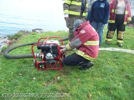Crews get the portable pump ready to deploy. The goal was to draft from the lake and pump water into a portable dump tank - from which the vacuum tanker would self-load.