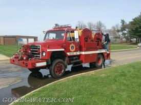 Hose 381 is a compact unit that proves quite capable of maneuvering on a fire scene or at a water supply source.