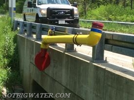 Before this type of dry fire hydrant can be designed and installed, a thorough assessment of the bridge and stream must be completed.