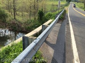 The arrangement of guard rail to road and water made for an optimum install.