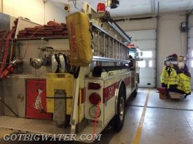 Engine 342 carries a 10-ft length of 6-inch suction hose in a tray on top of the officer low-side rear compartments.