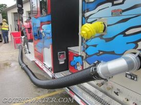 A 90-degree suction elbow in use during our water supply drill in Turtle, Wisconsin back in 2013.  The suction elbows are becoming more popular as folks move to the single-lane dump tank arrangement.  We all know that the side suction inlets on a midship mount fire pump far out perform any front intake, so the suction elbow is a real bonus in terms of drafting from the front without the restriction of a front intake.