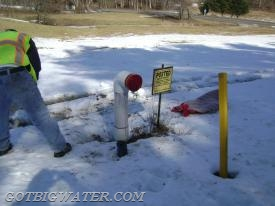 "A new suction head was installed. Unfortunately, the repair authorization work did not include any protective bollards. The yellow ""pole"" is really a wooden stake that marks the end of the plow area for the plow driver. Obviously, that did not work out so well!"