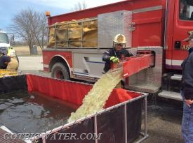 Tiffin Tanker 156 dumps its 2000 gallons of water in an effort to help sustain the 800 gpm sustained fire flow.