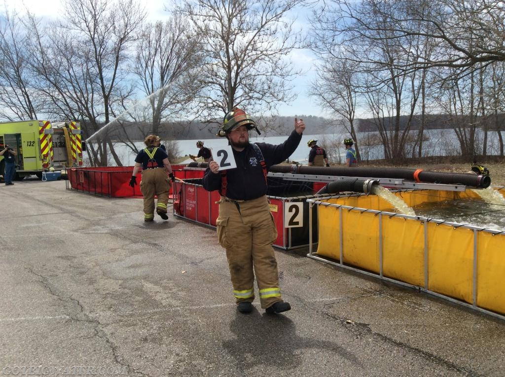"""This firefighter using handheld """"flip"""" signs directs tankers to the """"correct"""" dump tank....meaning the one in which the Dump Site Officer wants the water dumped. While this position does require another human being, on large scale ( 4 or more dump tanks) operations this position can really help keep things running smoothly."""