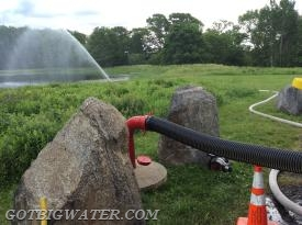Practicing drafting from a dry fire hydrant.