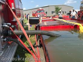 Sharpsville Engine 41 drafts and supplies jet siphons at the dump site.