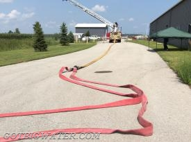 Wildcat Ladder 62 set up and ready for water supply. Dual, 3-inch lines feed a 5-inch line to the base of the ladder's pre-piped waterway.