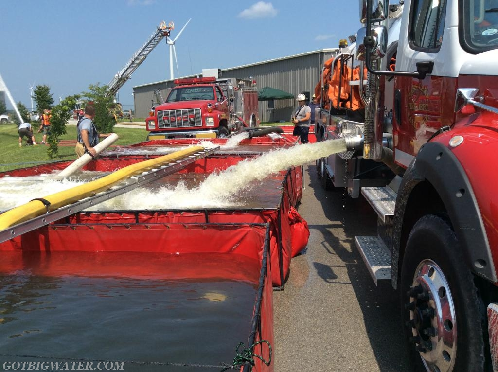 A four-dump tank set up was used to support the 1,100 gpm supply to the ladder truck.