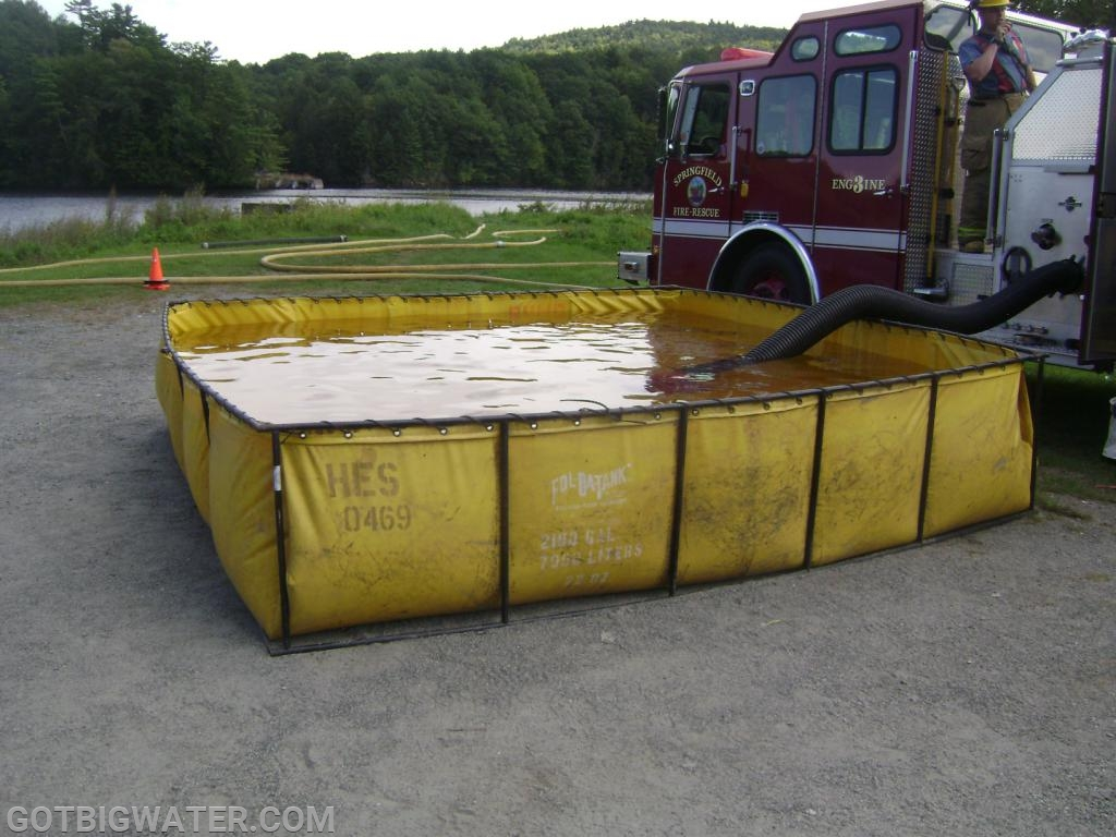 Portable pump output traveled through the LDH lines into the pumper and out into this dump tank for storage.