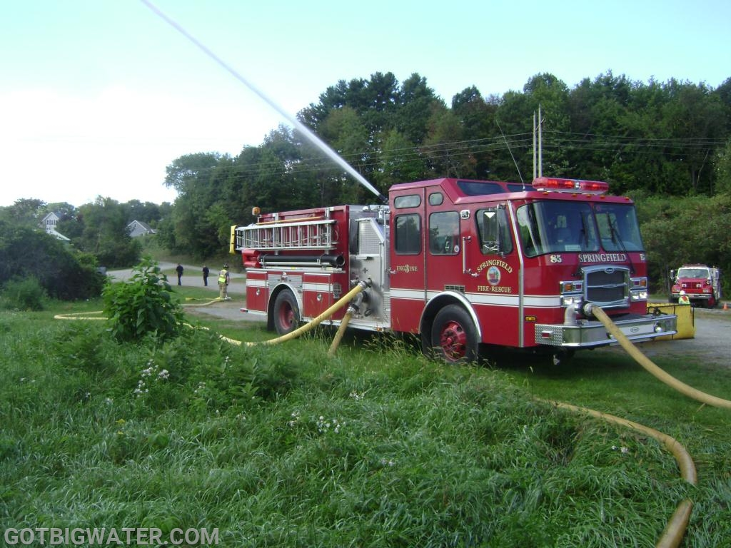 One portable pump fed the pumper's front intake...one portable pump fed the pumper's side intake.