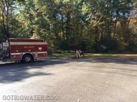 A 2-person ambulance crew works to connect the hydrant valve to the fire hydrant in order to supply water to the two engines already in the relay who are awaiting water.