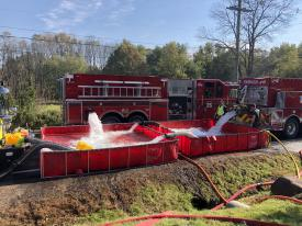 Sixteen tankers helped support this 1,000 gpm fire flow for 10-hours.