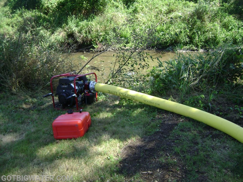 One of two portable pumps used to supply water for the operation.