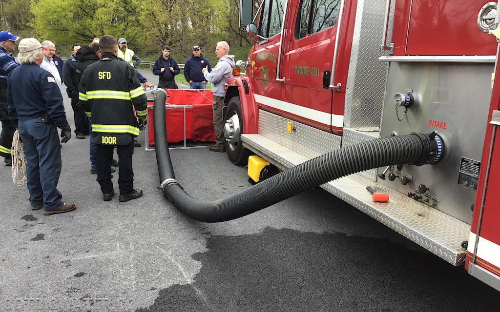 Reviewing drafting choices for when a dump tank is placed in front of a pumper.