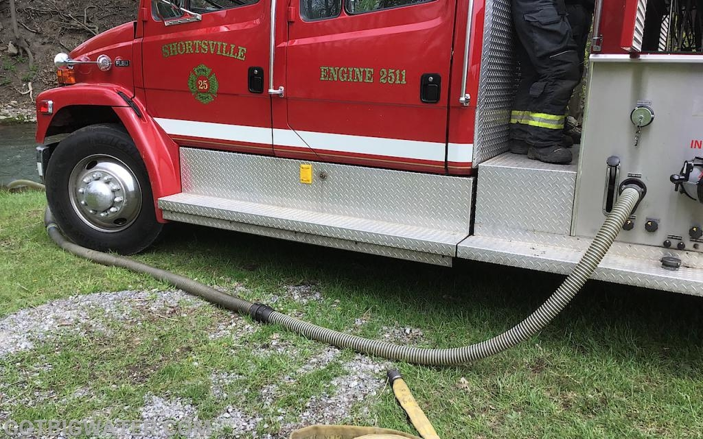 30-feet of 2-1/2-inch suction hose used to help this pumper increase its output. Six-inch suction hose is being used on the officer side suction inlet.