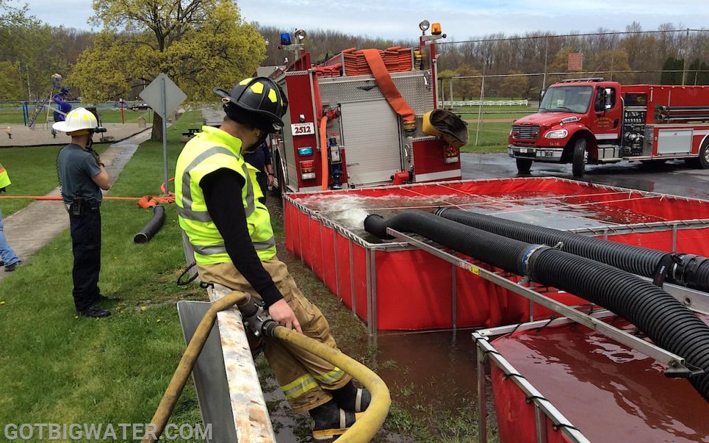 This firefighter's job is to control water transfer between tanks. He does that by opening and closing the gated-wye lines.