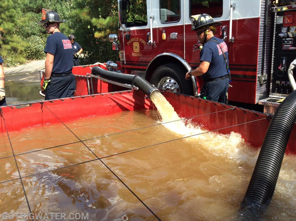 Dump site operations. SFTFR Engine 1 drafts and supplies water to Engine 3.