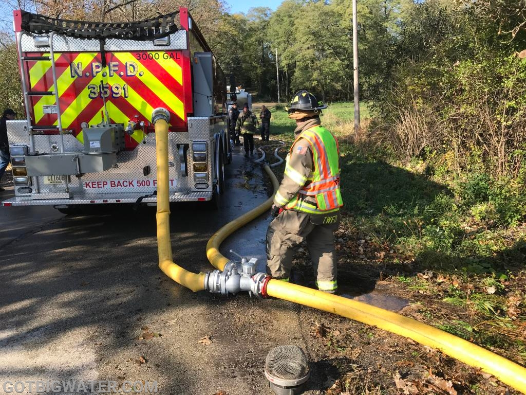 Getting loaded at the stream using 5-inch LDH right to the Fireman's Friend fill valve.
