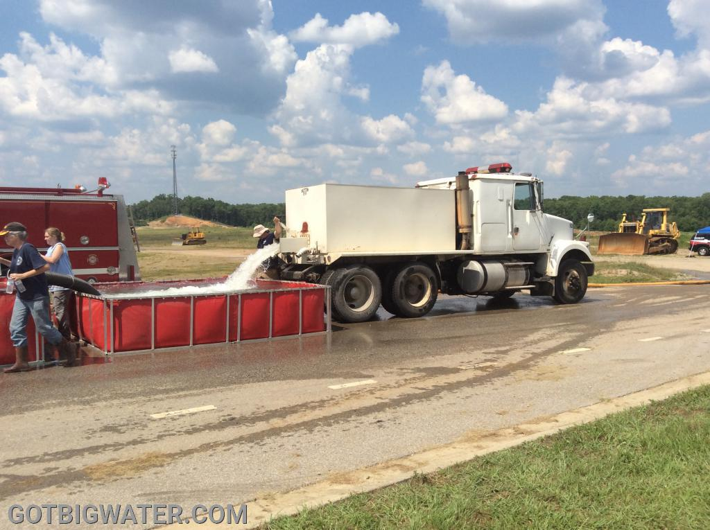Tanker 272 drops its load of water before heading to the fill site.