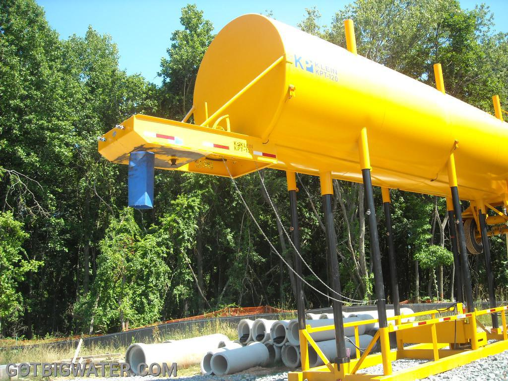The tank rests on a rigid frame system pinned in place and has a vinyl-like chute for dumping water.