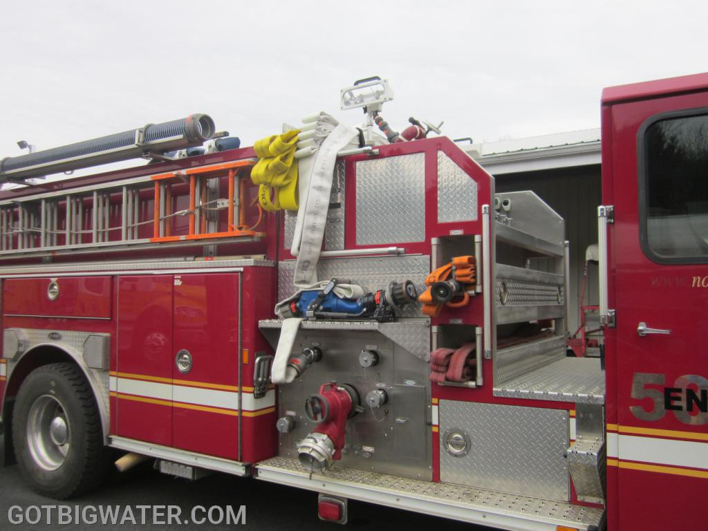 A pre-connected TFT Blitzfire rigged up on an oder E-One pumper.