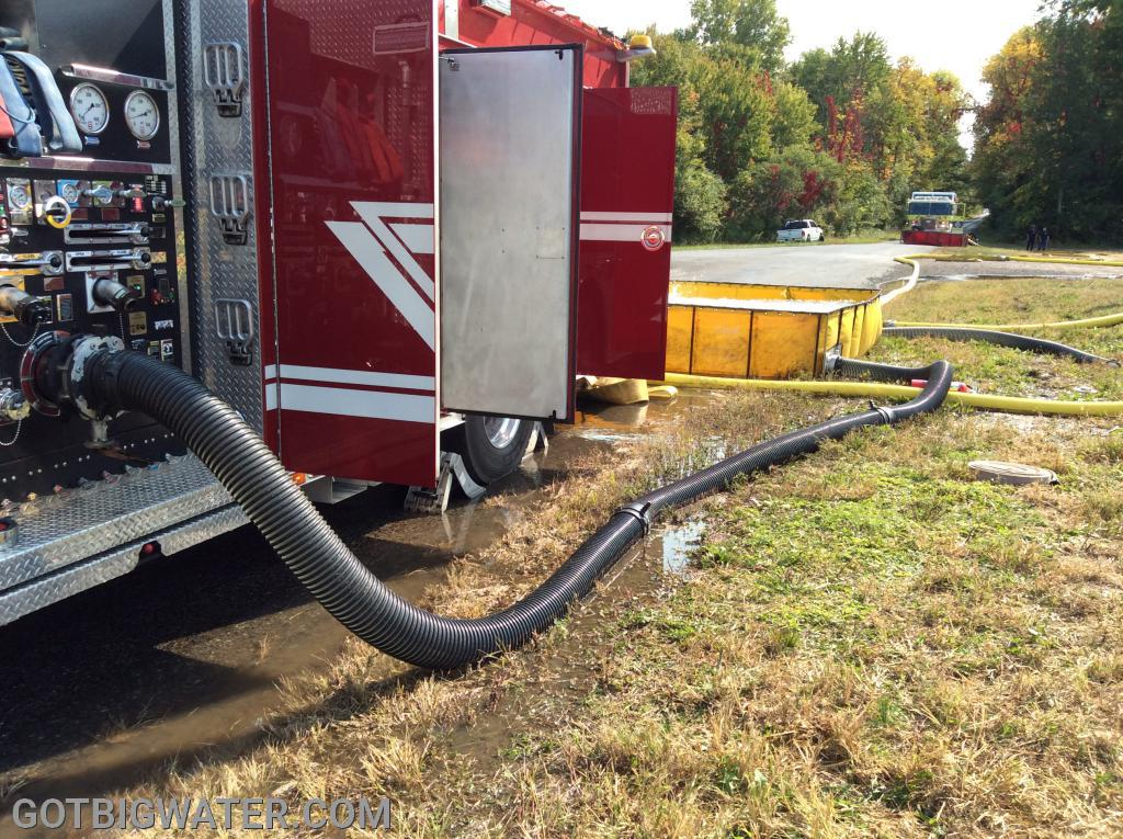 Three lengths of suction hose allowed the pumper to draft from a dump tank positioned to the rear of the rig....using a single-lane configuration.