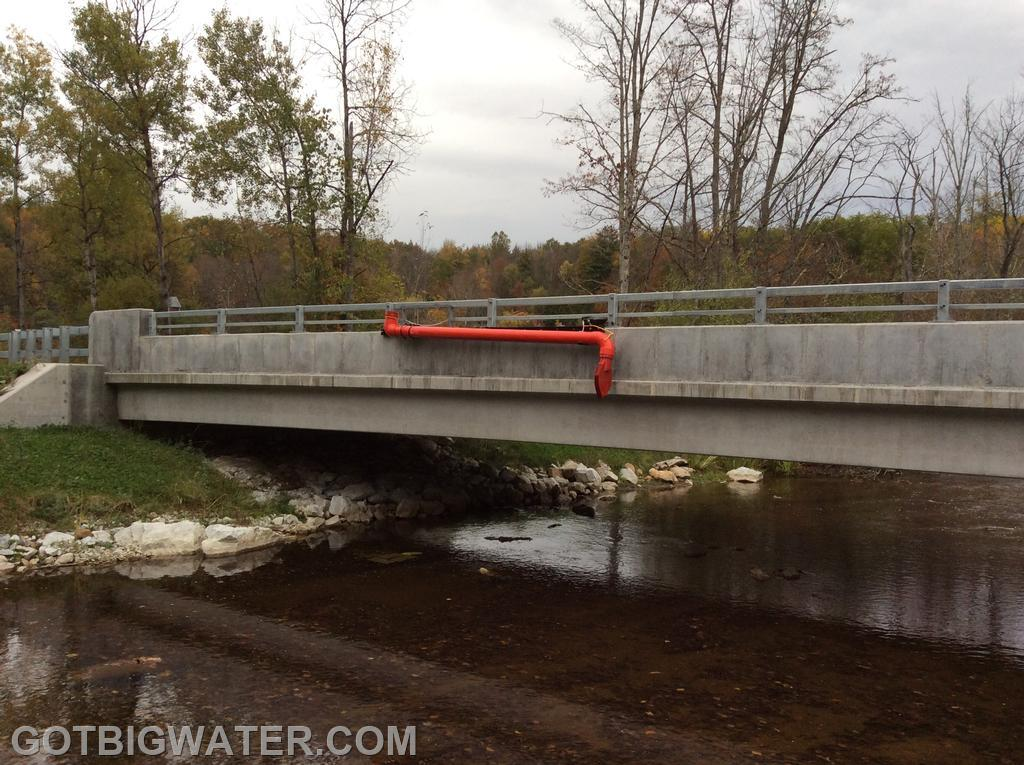 Town officials modified the bridge rail so that the suction head would deploy at a usable height for a pumper's suction inlet.