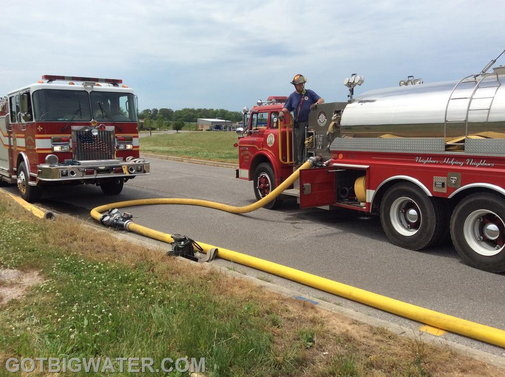 Brierfield Tanker 206 starts supplying water to the attack pumper using a nurse tanker operation until a dump site can be set up.